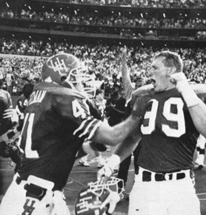 Pezman (left) and Kevin Labay celebrate UH's win over A&M at the Astrodome in 1990. Photo by Dale Toney. Image courtesy UH Libraries Digital Collection.