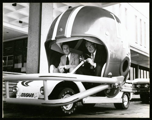 President Philip G. Hoffman and Rep. Price Daniel, Jr in a custom built club car. September 25, 1972. Special Collections, University of Houston Libraries. University of Houston Digital Library.