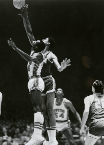 Elvin Hayes and Lew Alcindor mid-jump during the Game of the Century at the Houston Astrodome.